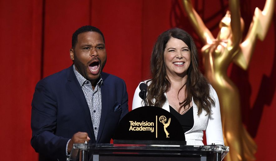 Anthony Anderson, left, reacts as he learns he is a nominee for best actor in a comedy series, as he and Lauren Graham appear at the 68th Primetime Emmy Nominations Announcements at the Television Academy's Saban Media Center on Thursday, July 14, 2016, in Los Angeles. (Photo by Chris Pizzello/Invision/AP)