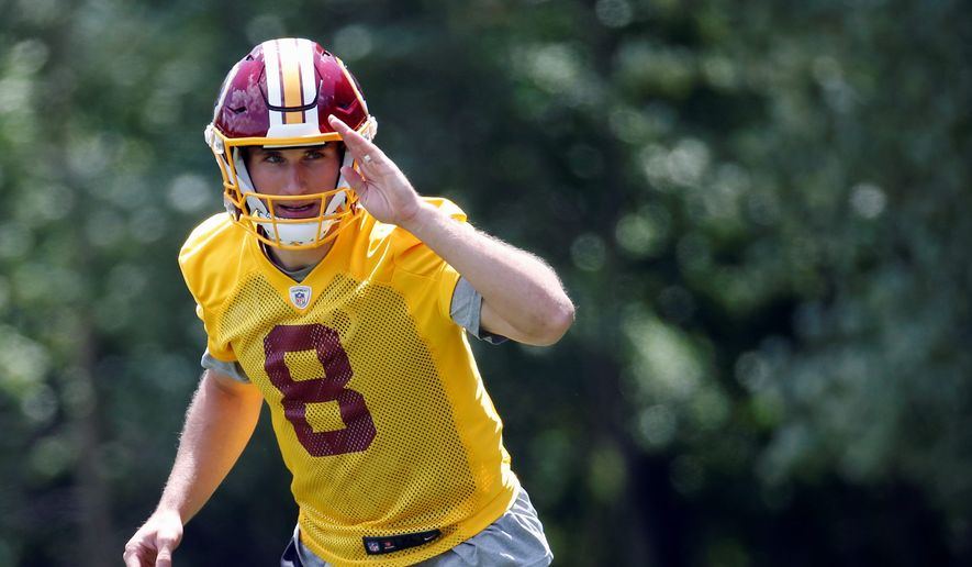 Washington Redskins quarterback Kirk Cousins seems content to play under the $19.95 million franchise tag this season if no deal is reached by Friday's deadline. (Associated Press)