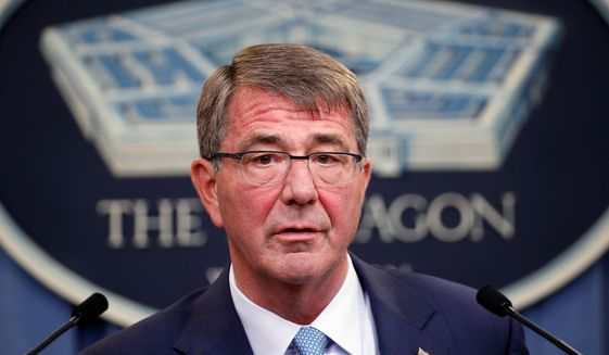 Defense Secretary Ashton Carter says transgenders are being hurt by an outdated approach that distracts commanders. (Associated Press)