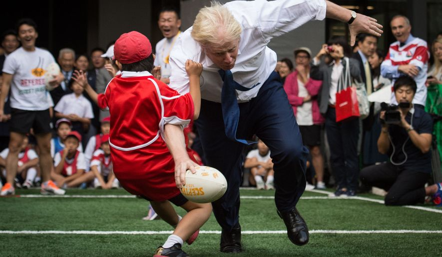 FILE - In this Oct. 15, 2015 file photo, Boris Johnson takes part in a Street Rugby tournament in a Tokyo street. Britains new top diplomat is shaggy-haired, Latin-spouting Boris Johnson, who in recent months has made insulting and vulgar comments about the presidents of the United States and Turkey.  (Stefan Rousseau/PA via AP) UNITED KINGDOM OUT NO SALES NO ARCHIVE