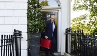 Newly appointed British Foreign Secretary Boris Johnson leaves his home in north London, as new Prime Minister Theresa May prepared to put the finishing touches to her top team, Thursday, July 14, 2016. (Lauren Hurley/PA via AP)