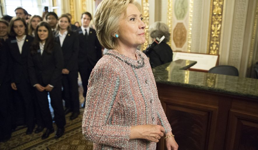 Democratic presidential candidate Hillary Clinton leaves a meeting with Senate Democrats on Capitol Hill in Washington, Thursday, July 14, 2016. (AP Photo/Evan Vucci)