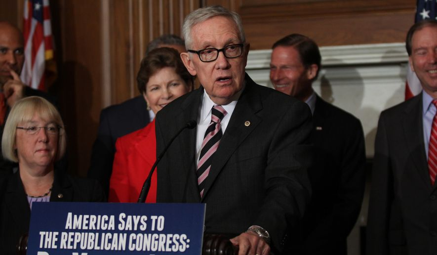 Senate Minority Leader Harry Reid of Nev. speaks to reporters on Capitol Hill in Washington, Thursday, July 14, 2016, to discuss unfinished business before Congress prior to its recess. Congress is about to leave for a seven-week vacation without giving the Obama administration any of the $1.9 billion it's seeking to battle the Zika virus, and a Senate effort to revive the nuts-and-bolts process of passing agency budgets faces another setback at the hands of Democrats. (AP Photo/Lauren Victoria Burke)