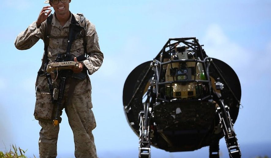 A U.S. Marine tests DARPA's Legged Squad Support System. (Facebook, DARPA, U.S. Marine Corps)