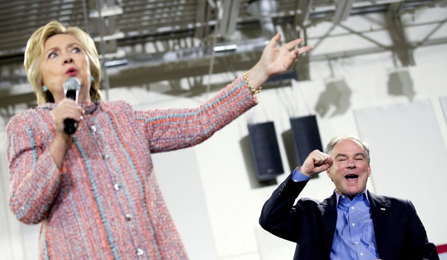 Democratic presidential candidate Hillary Clinton, accompanied by Sen. Tim Kaine, D-Va., right, speaks at a rally at Northern Virginia Community College in Annandale, Thursday, July 14, 2016. (AP Photo/Andrew Harnik) ** FILE **
