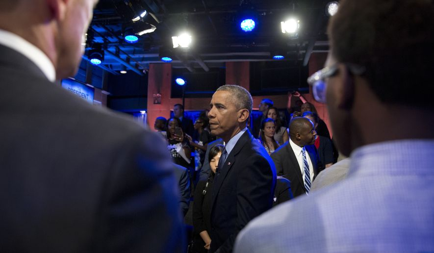 President Barack Obama greets people in the audience after participating in a town hall with ABC news anchor David Muir, officers, parents, students, community leaders and families on trust and safety in communities, Thursday, July 14, 2016, in Washington.  (AP Photo/Carolyn Kaster)
