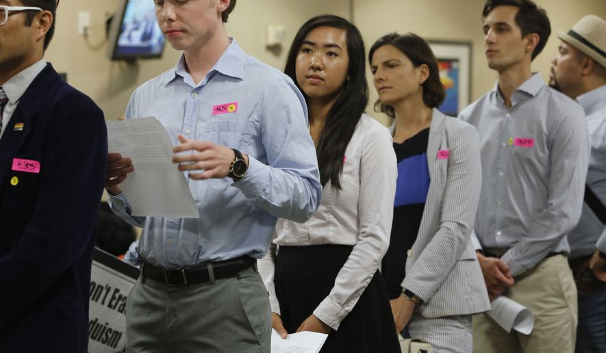 Allyson Chiu, 17, center, who will be a senior at Cupertino High, waits to with others to call on members of the State Board of Education to adopt proposed changes in classroom instruction to include prominent gay people and LGBT rights milestones in history classes, Thursday, July 14, 2016, in Sacramento, Calif. California education officials are considering the proposals as part of a broader overhaul of California's history and social science curriculum. (AP Photo/Rich Pedroncelli)