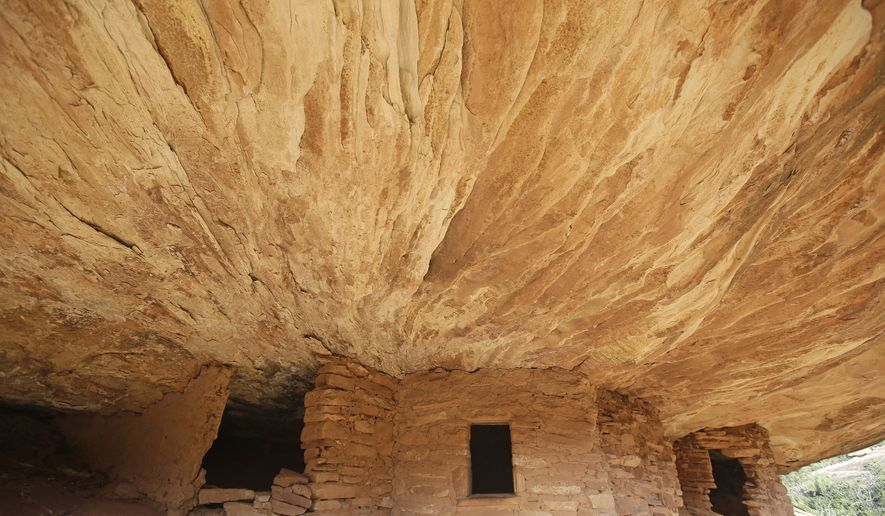 """This June 22, 2016, photo, the """"House on Fire"""" ruins are shown in Mule Canyon, near Blanding, Utah. These Anasazi ruins are found along a canyon hiking path in a dry river bed. They are one of an estimated 100,000 archaeological sites within a 1.9-million acre area of Utah's red rock country that a coalition of American Indian tribes and environmentalists want President Barack Obama to designate as a national monument to ensure protections of lands considered sacred. (AP Photo/Rick Bowmer)"""