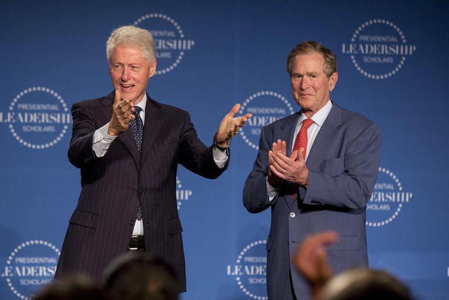 Former Presidents Bill Clinton, left, and George W. Bush celebrate with the Presidential Leadership Scholars during their graduation on Thursday, July 14, 2016, at Little Rock Central High School in Little Rock, Ark. (AP Photo/Gareth Patterson)