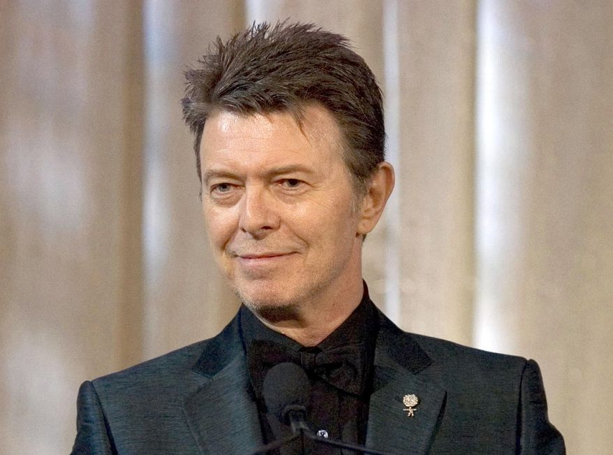 In this June 5, 2007, photo, singer David Bowie accepts the lifetime achievement award at the 11th Annual Webby Awards in New York. (AP Photo/Stephen Chernin, File)