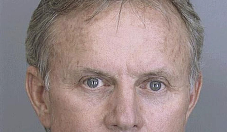 FILE - In this Nov. 2, 2001 file photo provided by the Dallas Sheriff Department, Dr. Wayne Scott Harrington, a Tulsa, Oklahoma dentist, is pictured in a booking photo in Dallas, following an arrest for DWI. Harrington is due to be sentenced Thursday, Jul 14, 2016 in federal court in Tulsa, Okla., on a money laundering charge. (AP Photo/Dallas Sheriff Department)