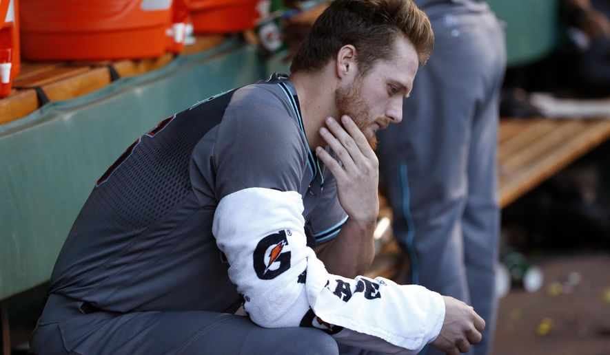 FILE - In this May 24, 2016, file photo, Arizona Diamondbacks starting pitcher Shelby Miller sits in the dugout during the team's baseball game against the Pittsburgh Pirates in Pittsburgh. The Diamondbacks have optioned struggling pitcher Miller to the Triple-A Reno Aces of the Pacific Coast League. The Diamondbacks said Thursday, July 14, that a corresponding move will be made Friday before the team's home game against the Los Angeles Dodgers. (AP Photo/Gene J. Puskar, File)