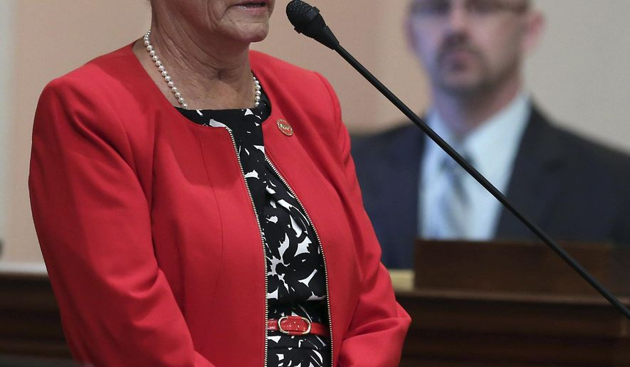 FILE - In this March 19, 2015 file photo, State Sen. Sharon Runner, R-Lancaster, addresses lawmakers at the Capitol in Sacramento, Calif. Runner, a Lancaster Republican who struggled for years with health problems, died Thursday, July 14, 2016, at home at the age of 62 following respiratory complications, her family and a spokeswoman said in a statement. (AP Photo/Rich Pedroncelli, File)
