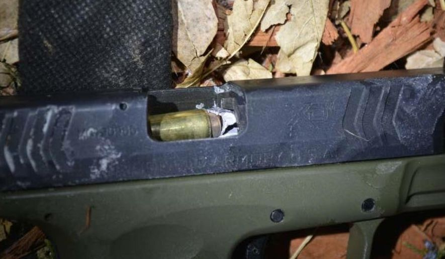 "This photo made available on July 14, 2016 by the Aurora Police Department, shows a close-up of an off-duty sheriff's deputy's bullet lodged inside the barrel of an assailant's gun, which investigators say was pointed at the deputy before the deputy fired at him, in Aurora, Colo. Investigators say Arapahoe County Deputy Jose Marquez fired a bullet straight down the barrel of the suspect's gun, a shot they called ""one in a billion."" The detail emerged in a letter from prosecutors announcing that Marquez was justified in shooting the attempted-robbery suspect, who survived. Marquez also was wounded in the January shooting and is still recovering. (Aurora Police Department via AP)"