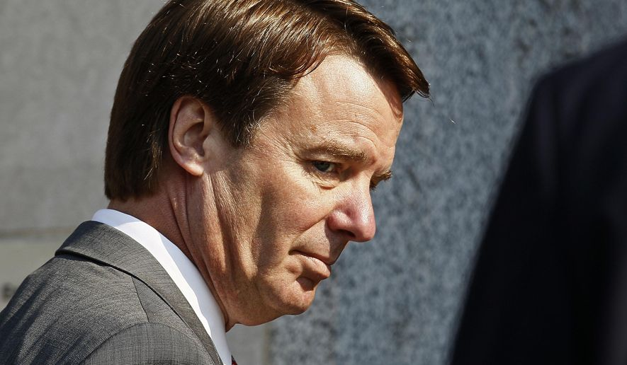 FILE - In this Friday, March 25, 2012 file photo, former U.S. presidential candidate and Sen. John Edwards arrives at a federal court for the sixth day of jury deliberations in Greensboro, N.C.. (AP Photo/Gerry Broome, File)