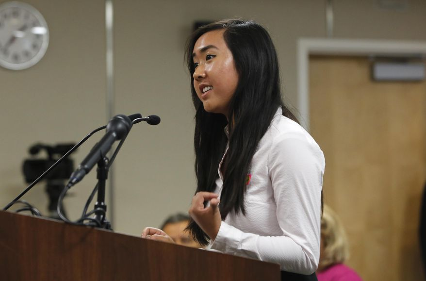Allyson Chiu, 17, a senior at Cupertino High School, was one of several speakers calling for members of the State Board of Education to adopt proposed changes in classroom instruction to include prominent gay people and LGBT rights milestones in history classes, Thursday, July 14, 2016, in Sacramento, Calif. California education officials are considering the proposals as part of a broader overhaul of California's history and social science curriculum. (AP Photo/Rich Pedroncelli)