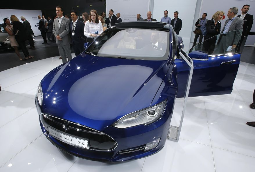 FILE - In this Sept. 15, 2015, file photo, a Tesla Model S is on display on the first press day of the Frankfurt Auto Show IAA in Frankfurt, Germany. Consumer Reports magazine is calling on electric car maker Tesla Motors to change the name of its Autopilot semi-autonomous driving system and to disconnect the automatic steering feature after a fatal crash in Florida. The magazine says in a statement that calling the system Autopilot promotes a dangerous assumption that Teslas can drive themselves. (AP Photo/Michael Probst, File)