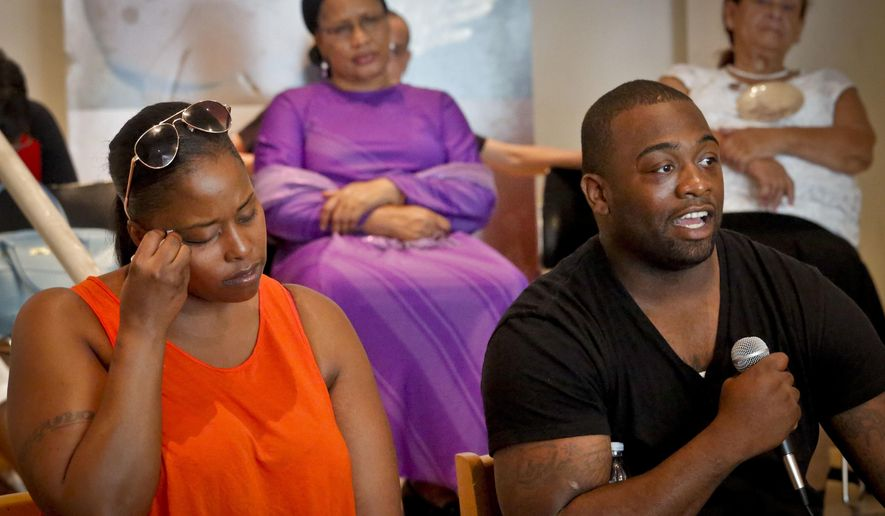 Delrawn Small's companion Zaquanna Albert, left, and his brother Victor Demsey, right, joined by members of Families United for Justice, an organization made up of families affected by police killings, hold a news conference Thursday July 14, 2016, at the Malcolm X and Dr. Betty Shabazz Center in New York. Small was killed in a road rage shooting by NYPD officer Wayne Issacs, who was placed on modified assignment after a security video appeared to cast doubt on his version of events. (AP Photo/Bebeto Matthews)