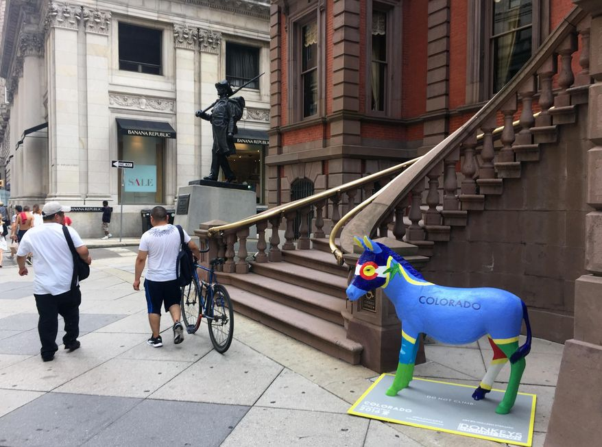 This July 7, 2016 photo shows a donkey outside the Union League in Philadelphia. It's one of 57 fiberglass donkeys placed around the city, which is hosting the Democratic National Convention this month. (AP Photo/Beth J. Harpaz)