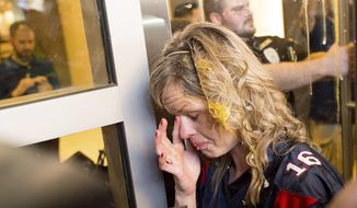 A woman wipes egg off her face after being pursued by protesters while leaving Republican presidential candidate Donald Trump's campaign rally in San Jose, California, June 2, 2016. (AP Photo/Noah Berger) ** FILE **