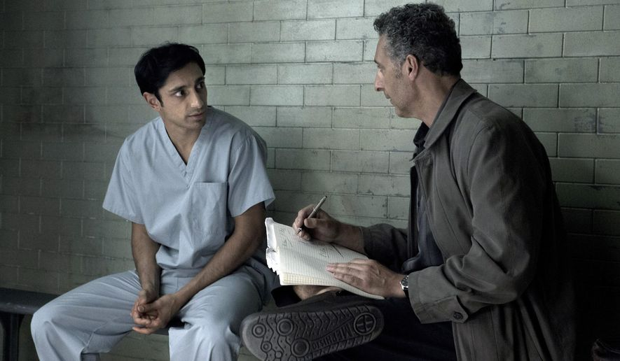 "In this image released by HBO, Riz Ahmed, left, and John Turturro appear in a scene from ""The Night Of,"" airing Sunday at 9 p.m. ET on HBO.  (Craig Blankenhorn/HBO via AP)"