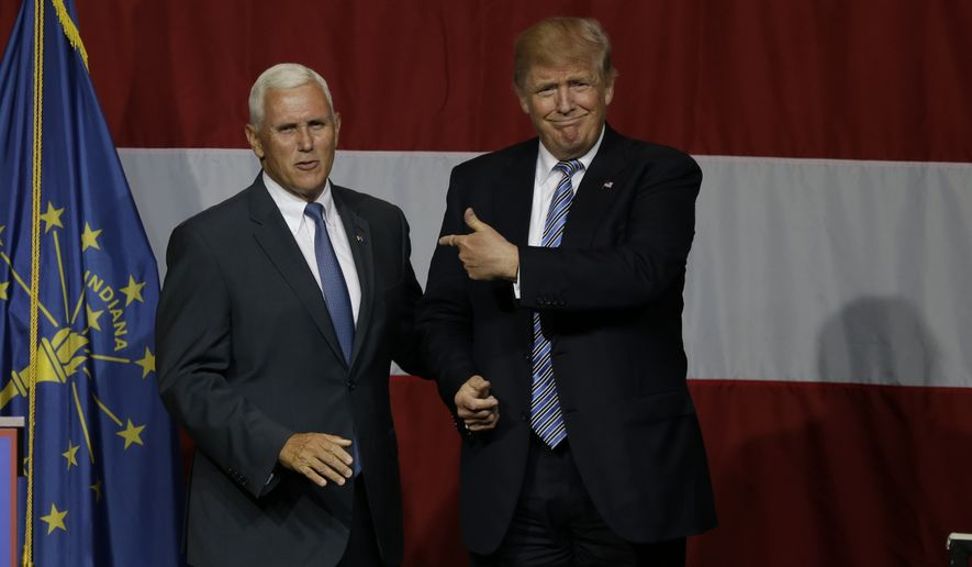 Indiana Gov. Mike Pence joins Republican presidential candidate Donald Trump at a rally in Westfield, Ind., on July 12, 2016. (Associated Press) **FILE**