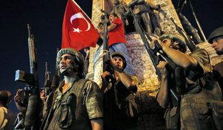 "Turkish soldiers secure the area as supporters of Turkey's President Recep Tayyip Erdogan protest in Istanbul's Taksim square, early Saturday, July 16, 2016. Turkey's prime minister says a group within Turkey's military has engaged in what appeared to be an attempted coup. Binali Yildirim told NTV television: ""it is correct that there was an attempt."" (AP Photo/Emrah Gurel)"