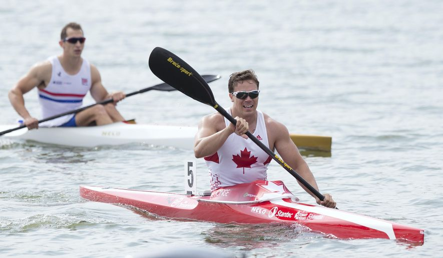 FILE - In this Aug. 10, 2014, file photo, Canada's Mark De Jonge, right, rides his canoe after winning at the K1 men 200m final of the ICF Canoe Sprint World Championships 2014 in Moscow, Russia. After winning bronze in London, the 32-year-old engineer heads to Rio as a double world champion and world-record holder in the event, which he has compared to a drag race on water. (AP Photo/Pavel Golovkin, File)