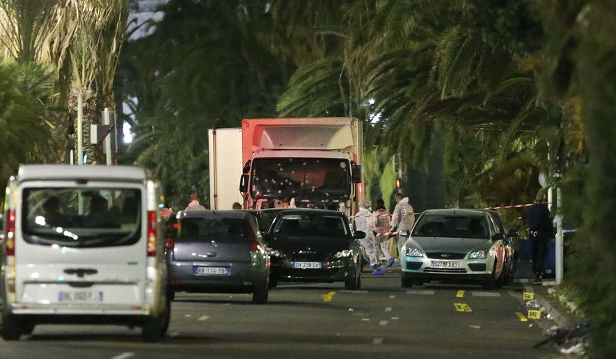 The truck which slammed into revelers late Thursday, July 14, is seen near the site of an attack in the French resort city of Nice, southern France, Friday, July 15, 2016. The truck loaded with weapons and hand grenades drove onto a sidewalk for more than a mile, plowing through Bastille Day revelers who'd gathered to watch fireworks in the French resort city of Nice late Thursday. (AP Photo/Luca Bruno) ** FILE **