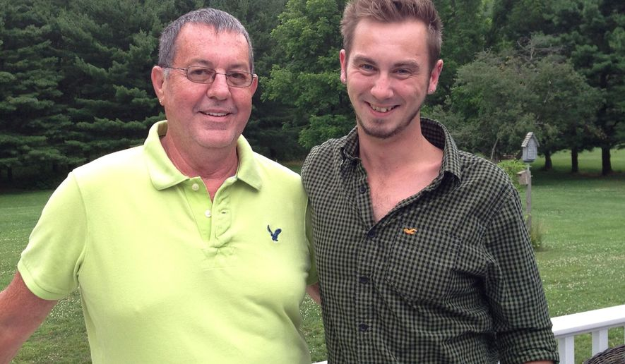 In this  June 23, 2016 photo, Ron Beachley, left, and his great-nephew Todd Garnand stand on the back deck of Beachley's home near Hagerstown, Md. Beachley, who is gay, says it boggles his mind that a pride festival, which is being organized by Garnand, is being held on the same downtown block where he was once afraid to be seen slipping into a gay nightclub. (AP Photo/David Dishneau)