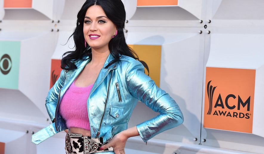 "FILE - In this April 3, 2016, file photo, Katy Perry arrives at the 51st annual Academy of Country Music Awards at the MGM Grand Garden Arena in Las Vegas. Perry released ""Rise"" on July 14, 2016. The single marks her first new music since her 2013 album, ""Prism."" (Photo by Jordan Strauss/Invision/AP, File)"