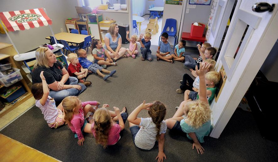 ADVANCED FOR RELEASE SATURDAY, JULY 23, 2016 Students at Kids Korner preschool start the day with circle time. The students are given a chance to talk about their activities the day before. Instructors also outline what students will be doing the rest of the day. (Monte LaOrange/The Post-Register via AP)