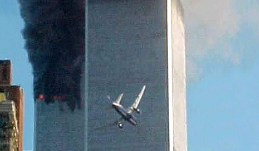 "FILE- In this Sept. 11, 2001 file photo, American Airlines Flight 175 closes in on World Trade Center Tower 2 in New York, just before impact. The government is preparing to release a once-classified chapter of a congressional report about the attacks of Sept. 11, that questions whether Saudi nationals who helped the hijackers with things like finding apartments and opening bank accounts knew what they were planning. House Minority Leader Nancy Pelosi said Friday July 15, 2016, that the release of the 28-page chapter is ""imminent."" (AP Photo/Carmen Taylor, File)"