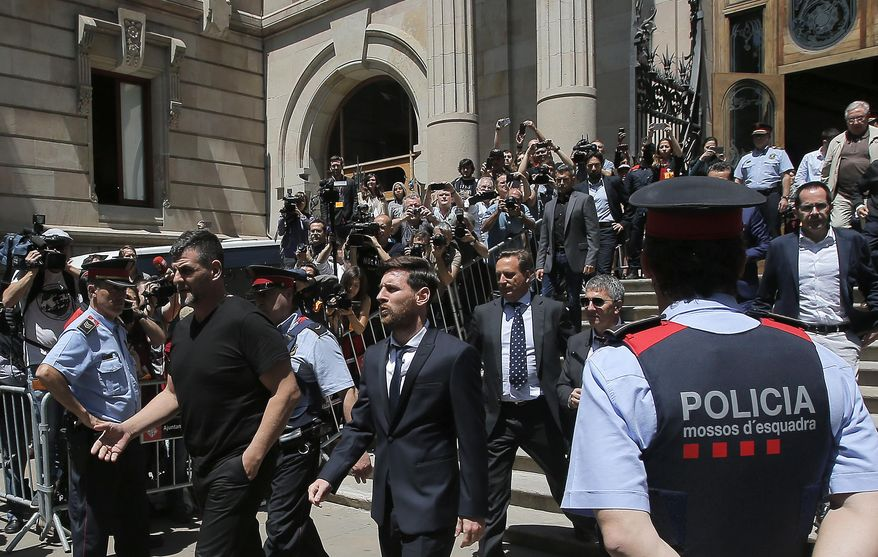 FILE - In this June 2, 2016 file photo, Barcelona soccer player Lionel Messi, center, leaves a court in Barcelona, Spain, Thursday, June 2, 2016. Barcelona has drawn widespread criticism for its campaign to support Lionel Messi after a court found the Argentine forward and his father guilty of tax fraud. Barcelona launched its social media campaign following last week's court verdict that found Messi and his father guilty of defrauding the Spanish state of 4.1 million euros ($4.6 million). (AP Photo/Manu Fernandez, File)