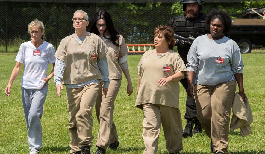 """In this image released by Netflix, Constance Shulman, from left, Lori Petty, Laura Prepon, Brad William Henke, background,  and Danielle Brooks, right, appear in a scene from, """"Orange is the New Black."""" (JoJo Whilden/Netflix via AP)"""