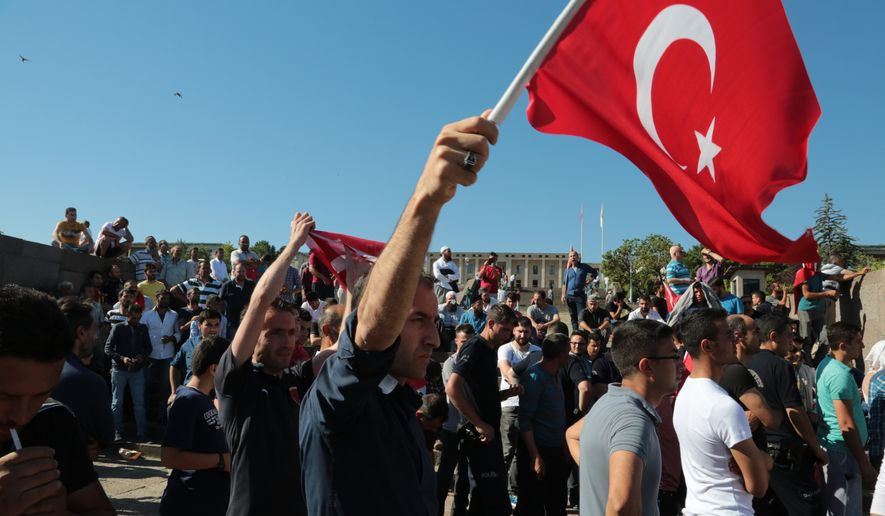 People protest against the coup, outside the Parliament in Ankara, Turkey, Saturday, July 16, 2016. (AP Photo/Burhan Ozbilici)