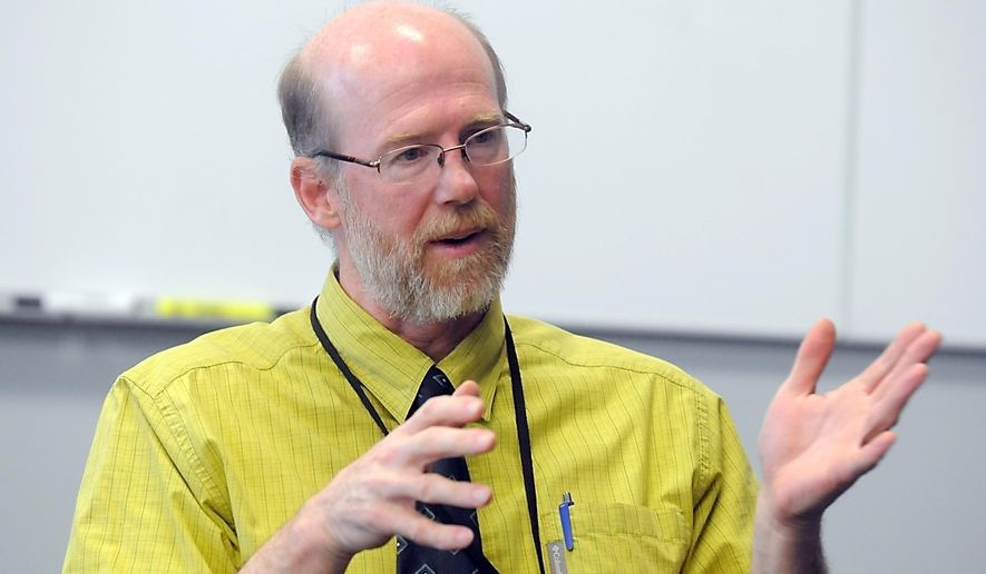 FOR RELEASE SATURDAY, JULY 16, 2016, AT 12:01 A.M. CDT.-  Dr. John McCabe, director of the University of Minnesota Mankato Family Medicine Residency program, discusses an incoming doctors shortage throughout Minnesota Tuesday, May 16. (Pat Christman/The Free Press via AP)