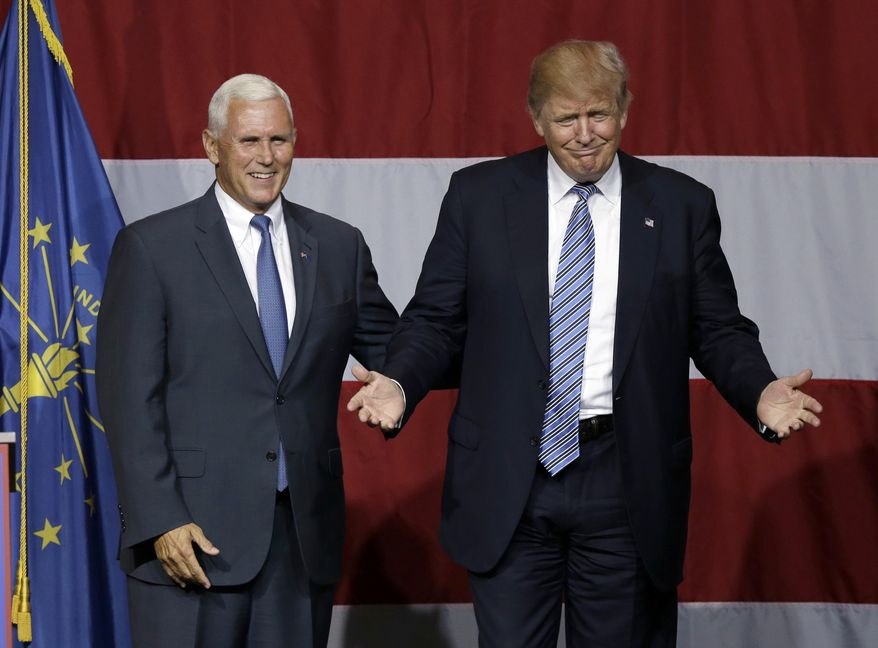 In this July 12, 2016 photo, Indiana Gov. Mike Pence joins Republican presidential candidate Donald Trump at a rally in Westfield, Ind. Over the past two decades, Trump has disagreed with his vice-presidential pick on plenty of political issues, including immigration policy, entitlement programs and trade. On social issues above all, Trump and Pence arrive at the 2016 general election from very different paths. (AP Photo/Michael Conroy, File)