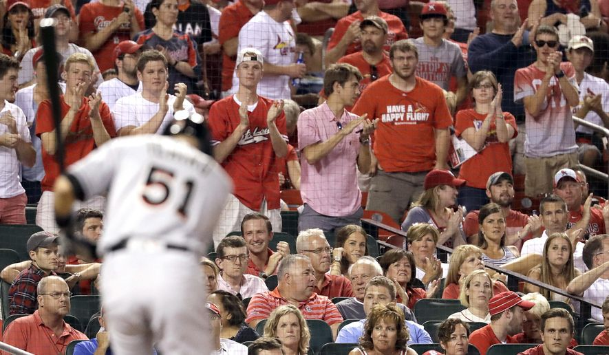 Fans cheer as Miami Marlins' Ichiro Suzuki prepares to bat during the eighth inning of a baseball game against the St. Louis Cardinals Friday, July 15, 2016, in St. Louis. (AP Photo/Jeff Roberson)