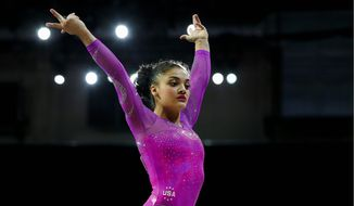 """U.S. gymnast Laurie Hernandez admits she's """"confident"""" and a """"crowd pleaser."""" (Associated Press)"""