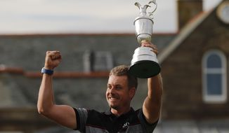 Henrik Stenson of Sweden poses with the trophy after winning the British Open Golf Championships at the Royal Troon Golf Club in Troon, Scotland, Sunday, July 17, 2016.  (AP Photo/Ben Curtis)