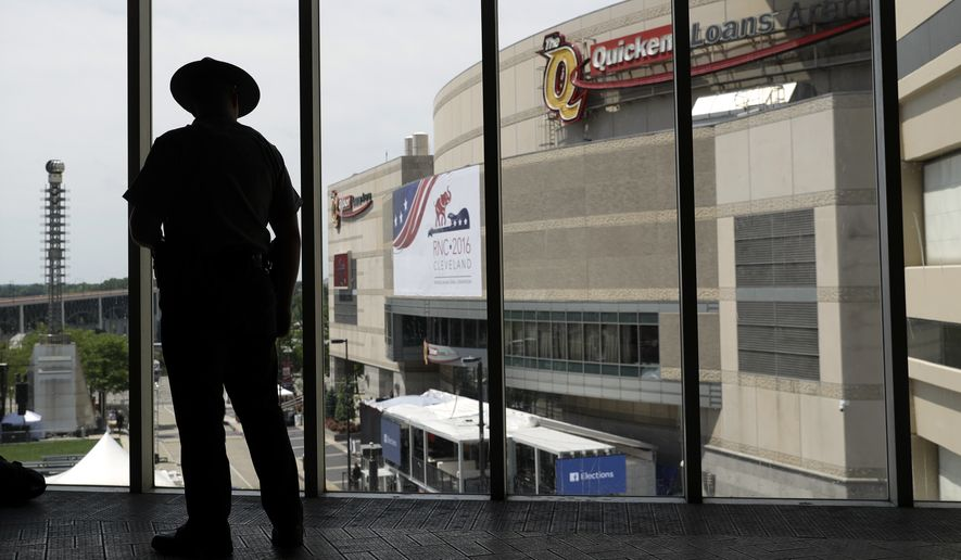 A trooper looks out to Quicken Loans Arena as preparations take place for the Republican National Convention the Republican National Convention, Sunday, July 17, 2016, in Cleveland. (AP Photo/John Locher)