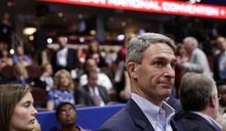 Former Attorney General of Virginia Ken Cuccinelli walks around the convention floor during first day of the Republican National Convention in Cleveland, Monday, July 18, 2016. (AP Photo/Matt Rourke)