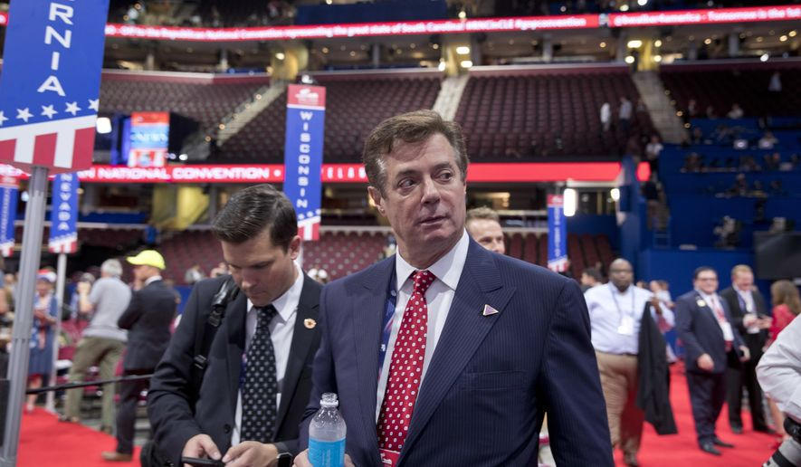 Trump Campaign Chairman Paul Manafort walks around the convention floor before the opening session of the Republican National Convention in Cleveland, Monday, July 18, 2016. (AP Photo/Carolyn Kaster) ** FILE **