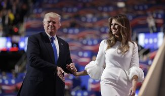 Republican presidential candidate Donald Trump walks off the stage with his wife Melania during the Republican National Convention, Monday, July 18, 2016, in Cleveland. (AP Photo/John Locher)