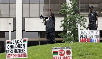 In this July 16, 2016 photo, people participate in a rally against racism, injustice and white supremacy, in Perk Park, before the Republican National Convention, in Cleveland, Ohio.  As Republicans prepare to convene their presidential nominating convention in Ohio, some prominent party figures are reaching anew for sensitivity after the latest racially tinged gun violence that left two more black men dead at the hands of police and five Dallas police officers struck down by the retaliatory bullets of a black sniper.  (AP Photo/Alex Brandon)