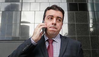 In this Jan. 8, 2016, file photo, Chris Correa, the former director of scouting for the St. Louis Cardinals, leaves the Bob Casey Federal Courthouse in Houston. (AP Photo/Bob Levey, FIle)