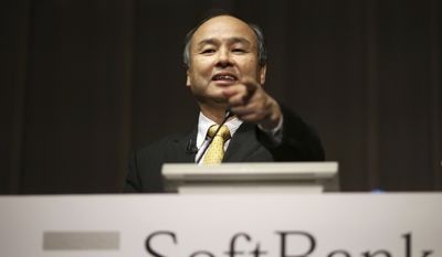 SoftBank founder and Chief Executive Officer Masayoshi Son speaks during a news conference in Tokyo, in this Nov. 4, 2014, file photo. Japanese technology company SoftBank Group Corp. is buying British semiconductor company ARM Holdings for $31 billion. (AP Photo/Eugene Hoshiko, File)