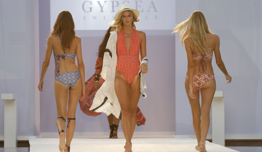 Models wearing Gypsea swimwear walk down the runway during the Hammock runway show, Friday, July 15, 2016, in Miami Beach, Fla. (AP Photo/Lynne Sladky)