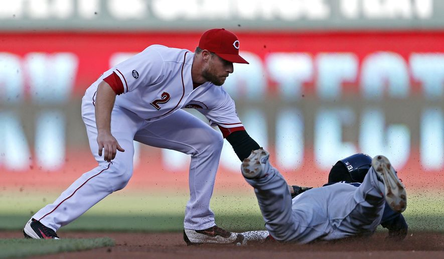 Cincinnati Reds shortstop Zack Cozart (2) puts the tag on Atlanta Braves Adonis Garcia on a steal-attempt during the first inning of a baseball game, Monday, July 18, 2016, in Cincinnati. (AP Photo/Gary Landers)